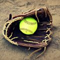 softball glove in dirt
